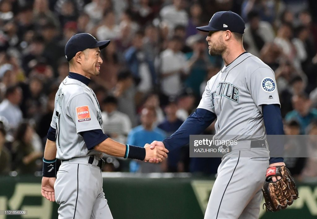 Seattle Mariners closer Hunter Strickland (R) and outfielder Ichiro Suzuki celebrate their win over Oakland Athletics after the bottom of the 12th inning at the Major League Baseball Japan Opening Series in Tokyo on March 21, 2019. - Japanese hit king Ichiro Suzuki announced his retirement on March 21, calling time on a record-breaking career that saw him shatter a host of Major League Baseball milestones. Baseball MLB Mariners Suzuki (Photo by Kazuhiro NOGI / AFP)        (Photo credit should read KAZUHIRO NOGI/AFP/Getty Images)